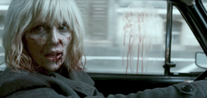 Charlize Theron in car inb Berlin in Atomic Blonde